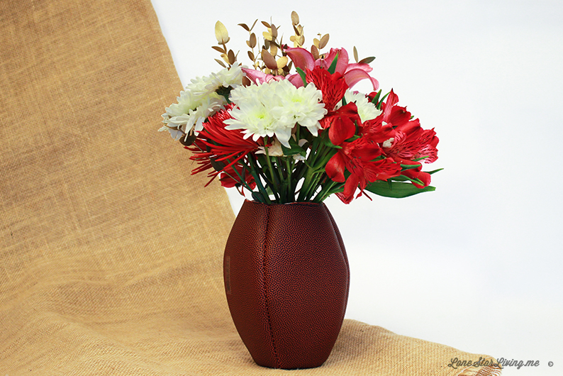 Sports flower arrangement with football vase